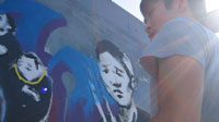Andy Huang creates the Underpass mural